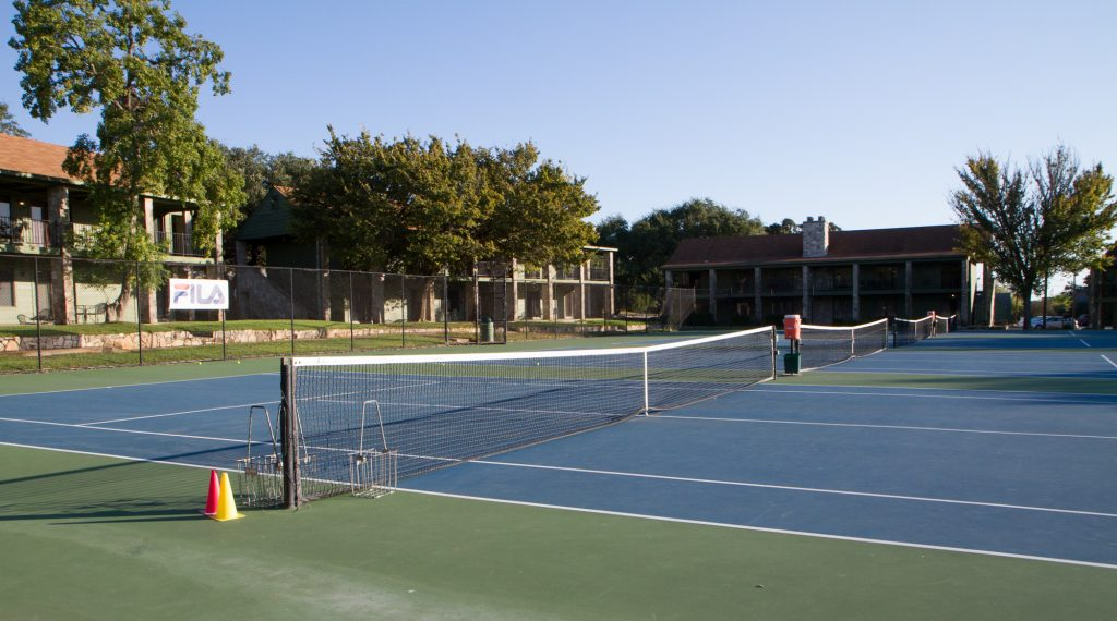 Hard courts, with condos in the background